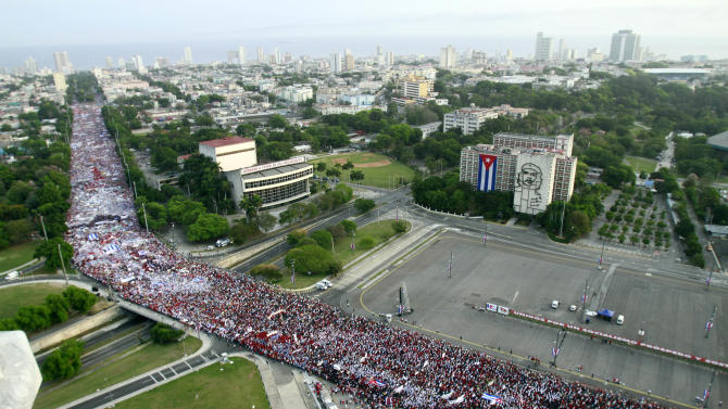 People fill a street during a May Day march to Revolution Square in Havana, Cuba, Wednesday, May 1, 2013. (AP Photo/Ismael Francisco, Cubadebate)