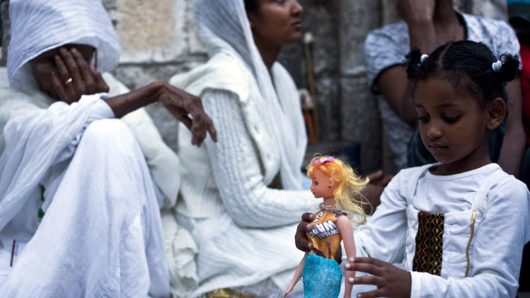 Ethiopian Orthodox worshippers wait for the Holy Fire ceremony at the Ethiopian section of the Church of the Holy Sepulchre in Jerusalem's Old City