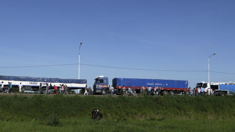 Argentine merchants and truckers hold a demonstration to protest the most recent measures by Paraguay's Customs in Clorinda
