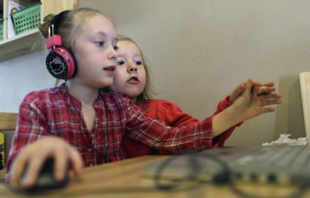 Coy Mathis, right, plays on the computer at their home in Fountain, Colo., Monday Feb. 25, 2013. Coy has been diagnosed with Gender Identity Disorder. Biologically, Coy, 6, is a boy, but to his parent
