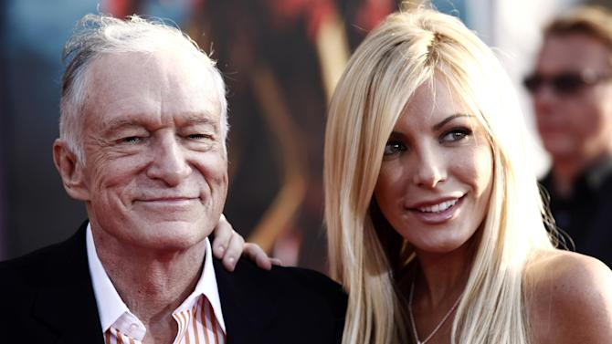 """FILE - In this April 26, 2010 file photo, Hugh Hefner, left, and Crystal Harris arrive at the premiere of """"Iron Man 2"""" at the El Capitan Theatre in Los Angeles.  Hefner and Harris obtained a marriage license in Beverly Hills, Calif. on  Tuesday Dec. 4, 2012, roughly a year-and-a-half after the centerfold called off the couple's previous engagement. (AP Photo/Matt Sayles, File)"""