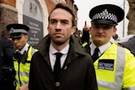 Trenton Oldfield (C) leaves Feltham Magistrates Court on April 23 after appearing in court charged with disrupting the Oxford-Cambridge boat race in a protest. London courts will work extended sessions during the Olympics to deal instantly with anyone committing offences linked to the Games, The Times reported Tuesday