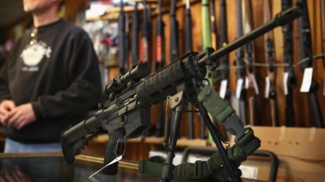 An AR-15 style rifle sits on display at the Freddie Bear Sports store in Tinley Park, Ill.