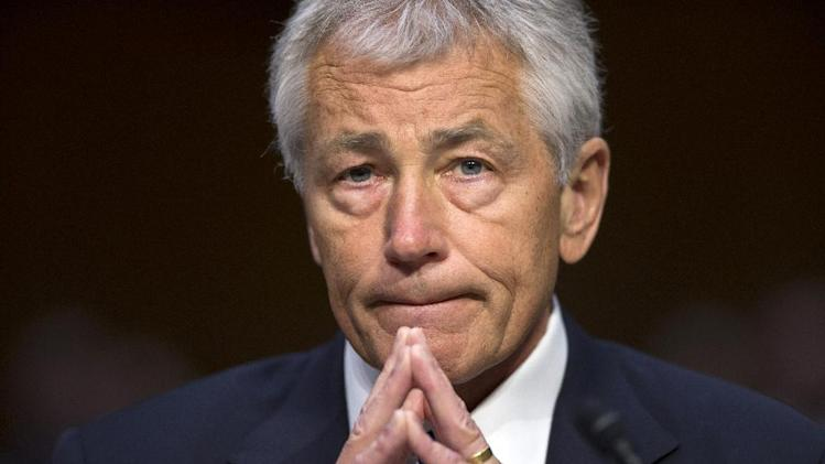 Defense Secretary Chuck Hagel listens on Capitol Hill in Washington, Wednesday, April 17, 2103, as he testified before the Senate Armed Services Committee hearing on the Pentagon's budget for fiscal 2014 and beyond. (AP Photo/J. Scott Applewhite)