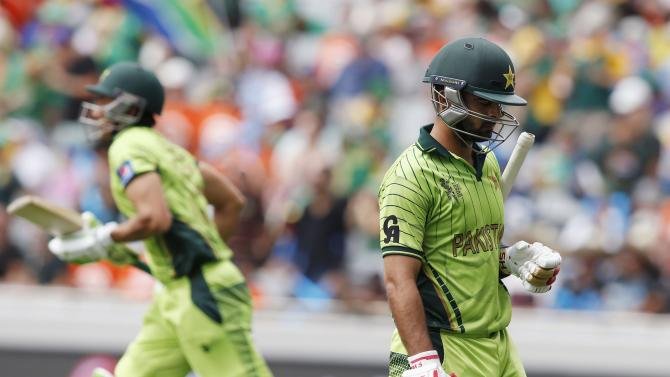 Pakistan's Ahmed Shahzad leaves the field after being dismissed during their Cricket World Cup match against South Africa in Auckland