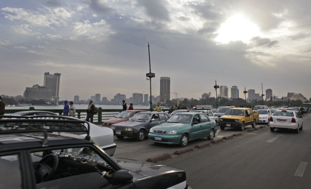 Traffic returns to the Kasr El-Nil bridge leading to Tahrir Square in downtown Cairo, Egypt Sunday, Feb. 6, 2011. A sense of normalcy began to return to some parts of the capital Sunday, which has been largely closed since chaos erupted shortly after the protests began on Jan. 25.
