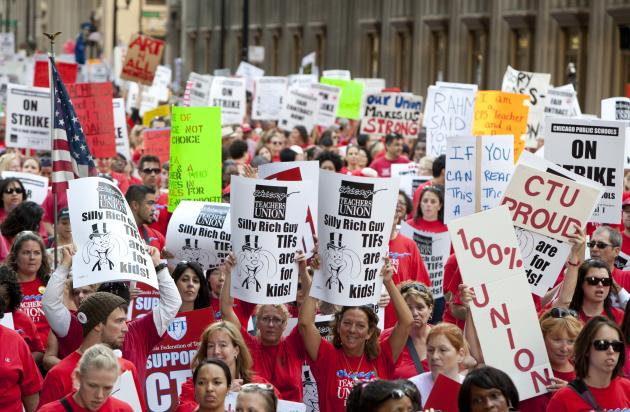 Thousands of public school teachers march for the second consecutive day on Tuesday, Sept. 11, 2012 in downtown Chicago. Teachers walked off the job Monday for the first time in 25 years over issues t