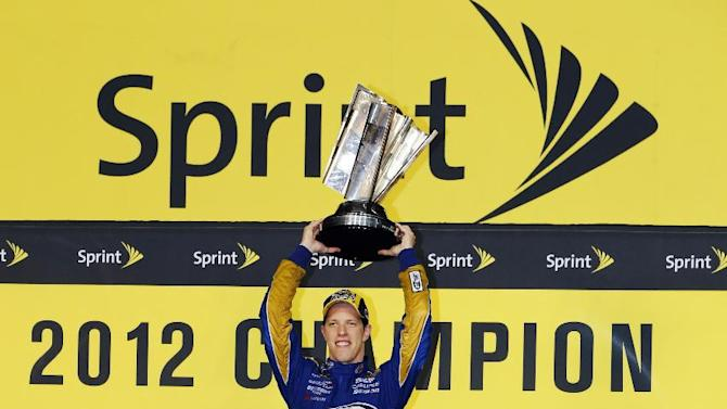 Brad Keselowski lifts the trophy after winning the NASCAR Sprint Cup Series championship following an auto race at Homestead-Miami Speedway, Sunday, Nov. 18, 2012, in Homestead, Fla. (AP Photo/Terry Renna)