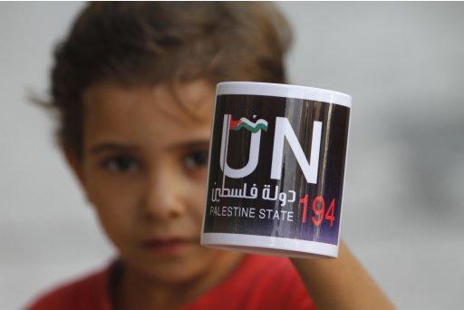 A Palestinian boy holds a coffee mug in Gaza City
