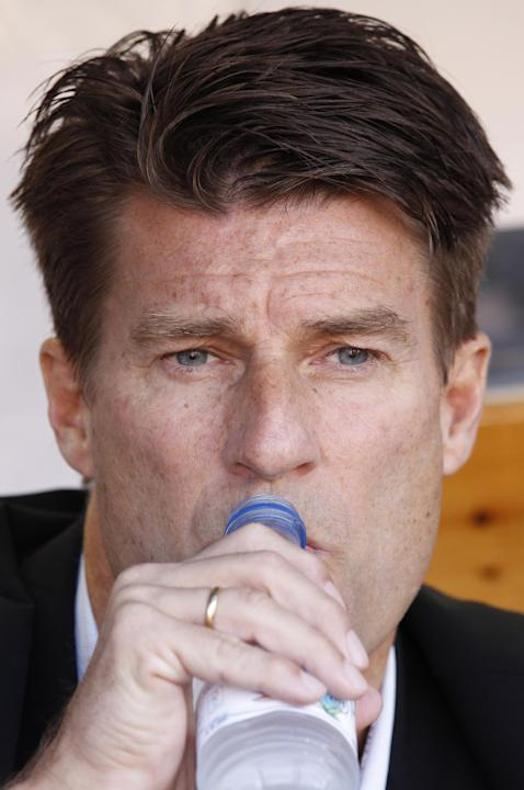 Swansea City's manager Michael Laudrup from Denmark drinks water before their Europa League Group A soccer match against Valencia at the Mestalla stadium in Valencia, Spain, Thursday, Sept. 19, 2013