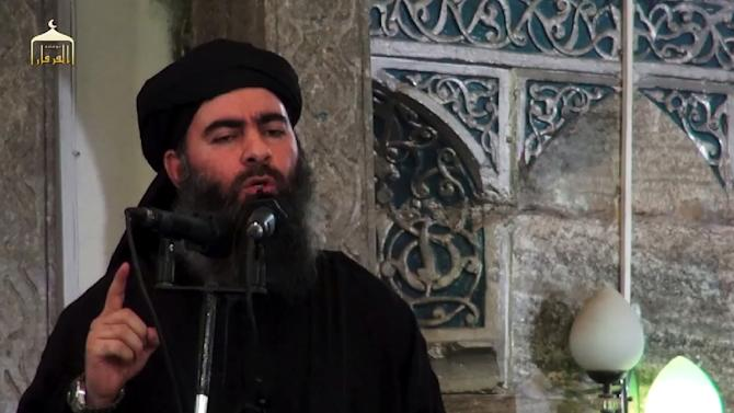 An image grab taken from a propaganda video released on July 5, 2014 by al-Furqan Media allegedly shows the leader of the Islamic State jihadist group, Abu Bakr al-Baghdadi addressing Muslim worshippers at a mosque in Mosul, Iraq