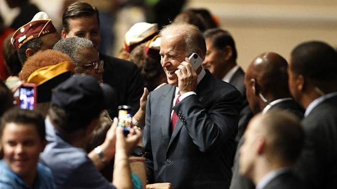 Vice President Joe Biden speaks on a cell phone from a member of the audience at the Disabled American Veterans National Convention in Las Vegas Saturday, Aug. 4, 2012. Vice President Joe Biden is praising America's veterans for the sacrifices they've made on behalf of their country. (AP Photo/Las Vegas Review-Journal, John Locher) LOCAL TV OUT; LOCAL INTERNET OUT; LAS VEGAS SUN OUT