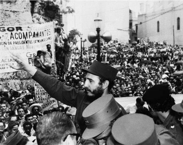 In this March 22, 1959, file photo, Fidel Castro, Cuba's Prime Minister, salutes the crowd at labor rally supporting him in Havana. Causes across the political spectrum have long used distinctive