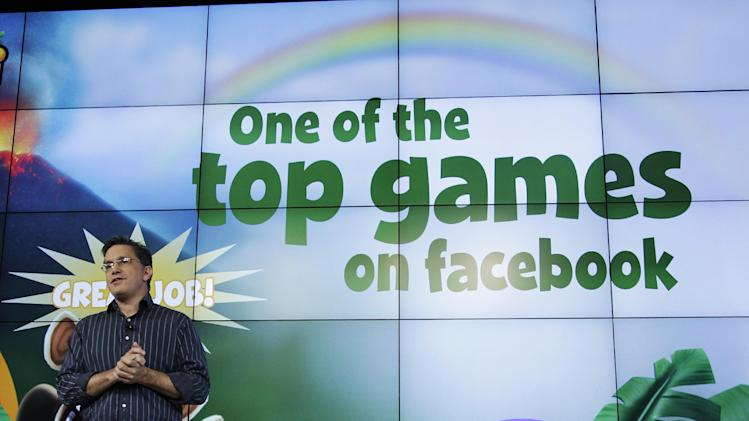Jim Veevaert, Zynga General Manager, talks about Facebook during an announcement at Zynga headquarters in San Francisco, Tuesday, June 26, 2012. Zynga said Tuesday it is expected to add more Web games to its digital arcade and introduce more ways to play them as it tries to lessen its dependence on Facebook and generate more revenue. (AP Photo/Paul Sakuma)