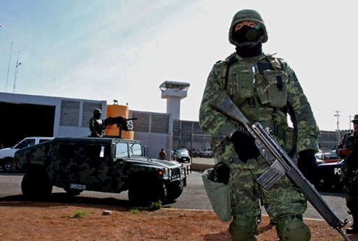 <p>Mexican soldier stand guard outside the Piedras Negras federal prison where a group of prisoners escaped on September 18, 2012. The Mexican authorities are hunting for the 131 escaped inmates near the US border.</p>