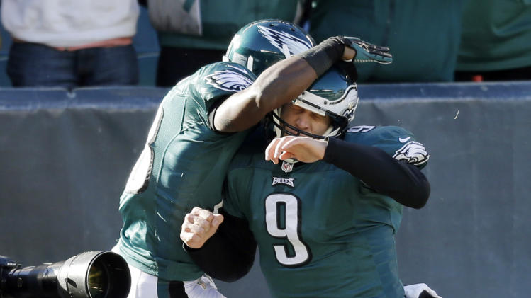 Philadelphia Eagles' Jeremy Maclin, left, and Nick Foles celebrate after a touchdown pass in the first half of an NFL football game against the Washington Redskins, Sunday, Dec. 23, 2012, in Philadelphia. (AP Photo/Michael Perez)