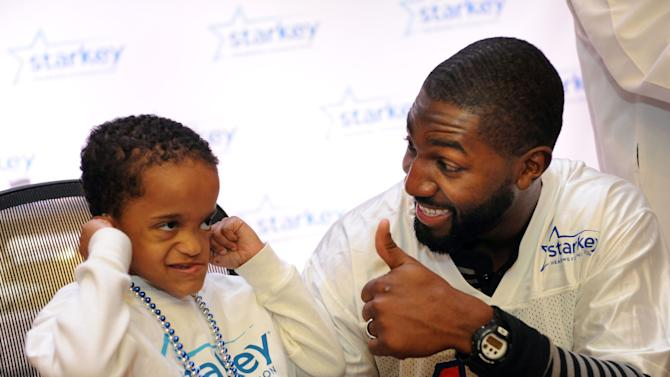 IMAGE DISTRIBUTED FOR STARKEY HEARING FOUNDATION - A young boy gets thumbs up from Green Bay Packer Greg Jennings after getting a new hearing aid from Starkey Hearing Foundation on Saturday, Feb. 2, 2013 in New Orleans. (Photo by Cheryl Gerber/Invision for Starkey Hearing Foundation/AP Images)