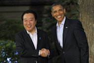 Japanese Prime Minister Yoshihiko Noda is welcomed by US President Barack Obama at the G8 summit in Camp David, on May 18. Leaders of the major industrial economies are meeting for a G8 Summit at Camp David this weekend to try to head off a full-blown financial crisis in Europe. AFP PHOTO / Pool / Philippe Wojazer