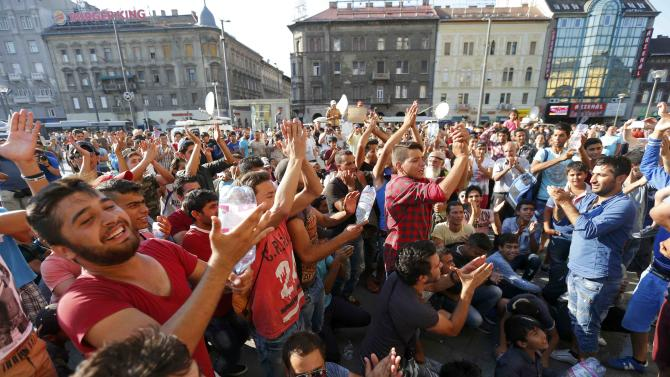 Migrants demonstrate outside the main Eastern Railway station in Budapest