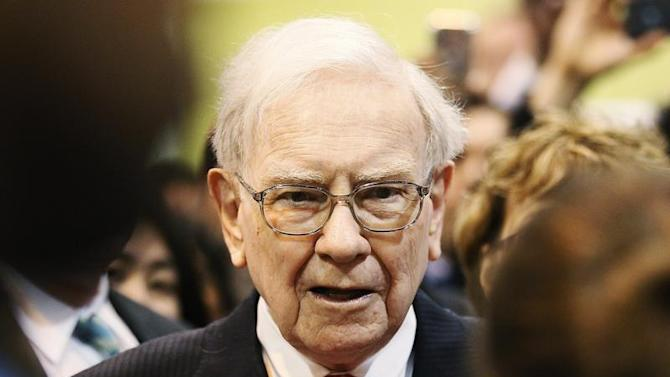 Berkshire Hathaway Chairman Buffett talks with a shareholder before the company's annual meeting in Omaha