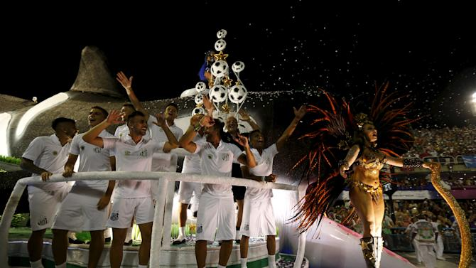 Players of Brazilian soccer club Santos parade with Grande Rio samba school during the carnival parade at the Sambadrome in Rio de Janeiro