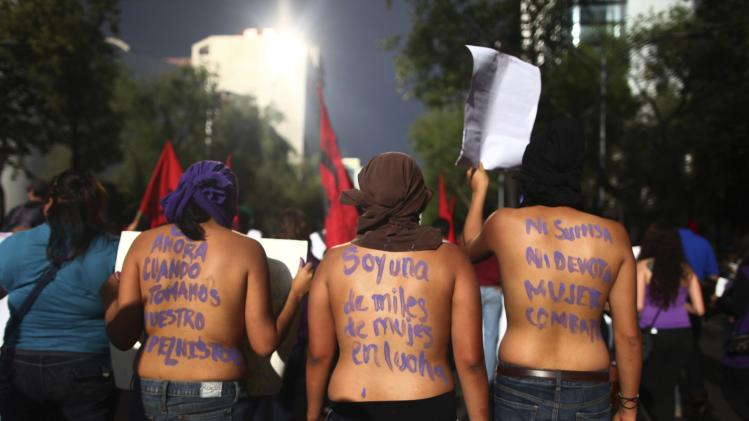 Women take part in a march to mark International Women's Day in Mexico City