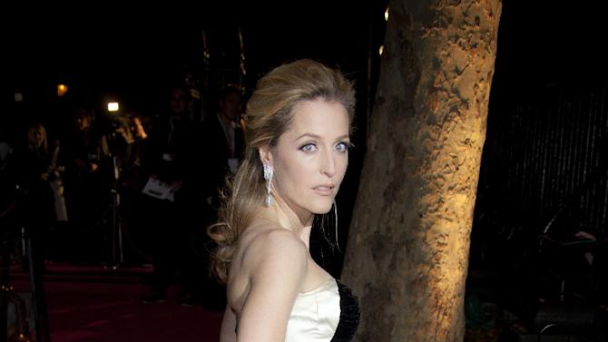 Actress Gillian Anderson arrives on the red carpet for the BFI 2011 London Film Festival Awards at St Luke's in east London, Wednesday, Oct. 26, 2011. (AP Photo/Joel Ryan)