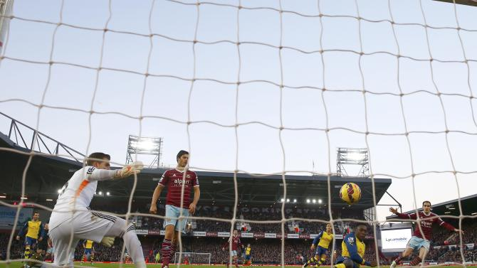 Arsenal's Danny Welbeck shoots to score against West Ham United during their English Premier League soccer match at Upton Park in London