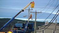A Newfoundland Power crew tackled power lines damaged by tropical storm Leslie.