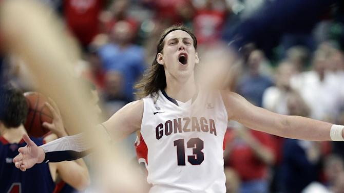 FILE - In this March 11, 2013, file photo, Gonzaga's Kelly Olynyk reacts after Saint Mary's called timeout during the second half of the West Coast Conference tournament championship NCAA college basketball game in Las Vegas. (AP Photo/Julie Jacobson, File)