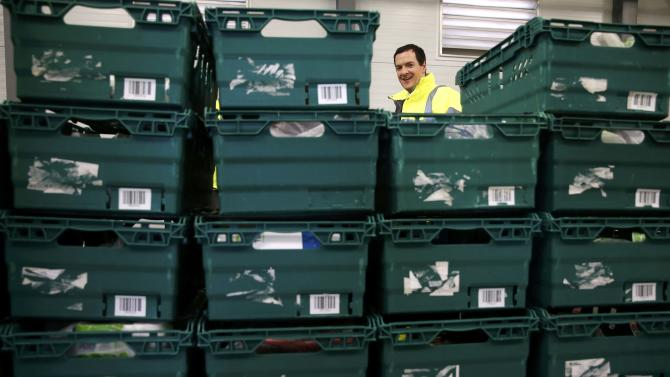 Britain's Chancellor of the Exchequer George Osborne visits a supermarket distribution centre during a campaign stop in Chemlsford, southern England
