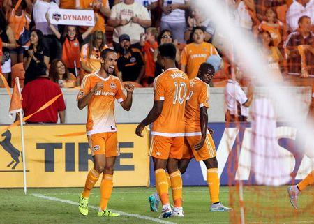 Dynamo stuns nine-man Whitecaps 2-0