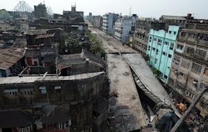 A 100-metre section of flyover collapsed onto a crowded…