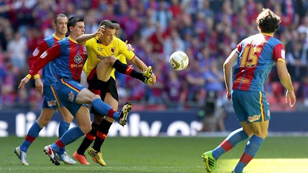 Watford's Jonathan Hogg (right) and Crystal Palace's Owen Garvan (left) battle for the ball (PA)