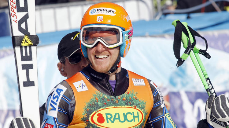 Ted Ligety, of the United States, smiles after winning an alpine ski, men's World Cup giant slalom in Kranjska Gora, Slovenia, Saturday, March 10, 2012. (AP Photo/Armando Trovati)