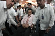 Chief Justice on wheels: Chief Justice Renato Corona returns to the session hall in a wheelchair. (NPPA Images)&lt;br&gt;&lt;br&gt;&lt;a target=&quot;_blank&quot; href=&quot;http://ph.news.yahoo.com/corona-to-impeachment-court--i-am-innocent.html&quot;&gt;Story: Corona &#39;walks out&#39;&lt;/a&gt;