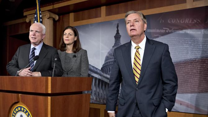 Sen. John McCain, R-Ariz., ranking Republican on the Senate Armed Services Committee, left, accompanied by fellow committee members, Sen. Kelly Ayotte, R-N.H., center, and Sen. Lindsey Graham, R-S.C., speaks during a news conference on Capitol Hill in Washington, Wednesday, Nov. 14, 2012, where he said he would do all he could to block the nomination of United Nations Ambassador Susan Rice to replace Secretary of State Hillary Rodham Clinton because of comments she made after the deadly Sept. 11 attack on the U.S. consulate in Benghazi.  (AP Photo/J. Scott Applewhite)