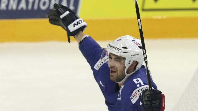 France's Fleury celebrates after scoring against Austria during their Ice Hockey World Championship game at the O2 arena in Prague