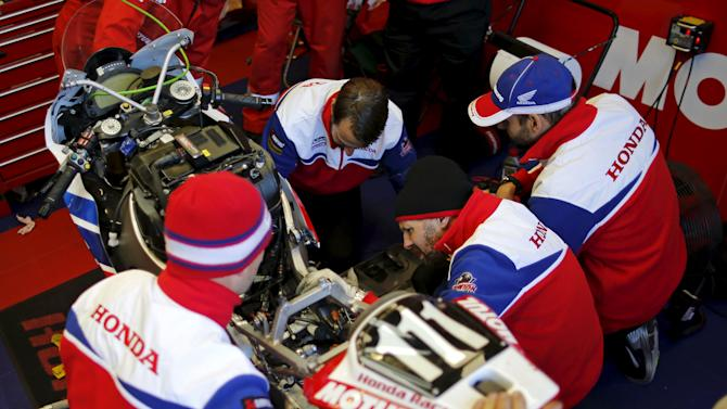 Technicians work on the Honda number 111 during the 38th Le Mans 24 Hours motorcycling endurance race in Le Mans