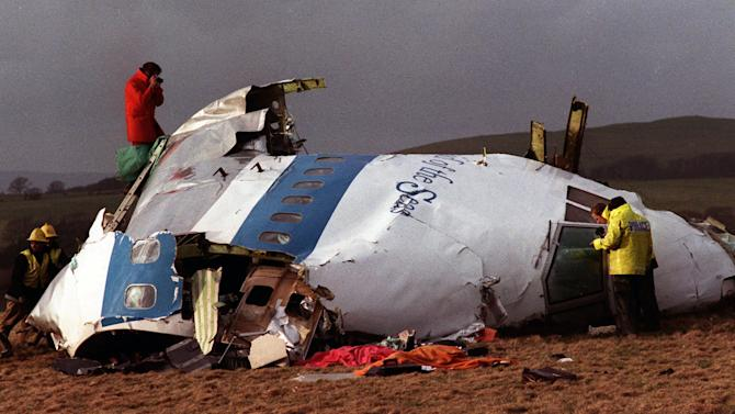 "FILE -  In this Dec 22, 1988 file photo  Police and investigators look at what remains of the flight deck of Pan Am 103 on a field in Lockerbie, Scotland.  Swedish tabloid Expressen said Wednesday Feb. 23, 2011 that Libya's recently resigned justice minister claims Moammar Gadhafi personally ordered the Lockerbie bombing that killed 270 people in 1988.  Expressen quotes Mustafa Abdel-Jalil as telling their correspondent in Libya that ""I have proof that Gadhafi gave the order about Lockerbie."" The comments were translated from Arabic to Swedish. (AP Photo/File)"