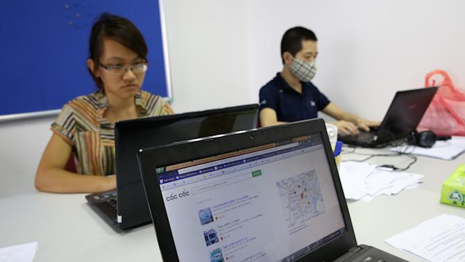 The interface of Coc Coc, the search engine of a new launched Russian- Vietnamese web company which is developing its Coc Coc to compete with Google for the local marrket in Ha Noi, Viet Nam Wednesday, May 14, 2013. The company has so far spent $10 million, hired 300 staff _ included 30 foreigners, mostly Russians and according to founders, its investors have $100 million over the next five years to try and get a chunk of the 97 percent of Vietnamese web surfers who currently use Google to switch. (AP Photo/Na Son Nguyen).