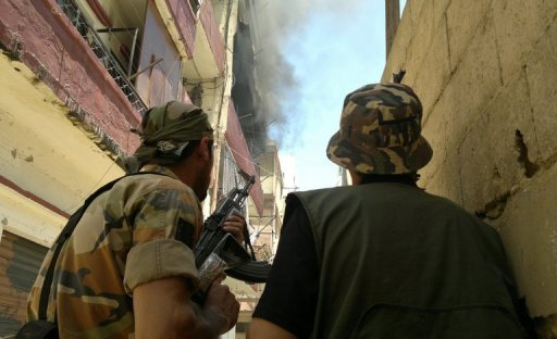 Lebanese militants look at smoke billowing after fierce clashes in Tripoli's Bab al-Tabbaneh neighbourhood on June 2. Saudi Arabia has urged its citizens to avoid travel to Lebanon, amid escalating tensions on the border with unrest-swept Syria