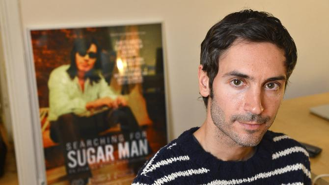 """FILE - A Dec. 18, 2012 photo from files showing Swedish Academy Award-winning documentary filmmaker Malik Bendjelloul. Police in Sweden say the film director behind the Oscar-awarded music documentary """"Searching for Sugarman,"""" Malik Bendjelloul died Tuesday, May 13, 2014. He was 36. Police spokeswoman Pia Glenvik said Bendjelloul died in Stockholm late Tuesday, but wouldn't specify the cause of death. She said no crime is suspected in relation to the Swedish film maker's death. (AP Photo/TT, Anders Wiklund, file) SWEDEN OUT"""