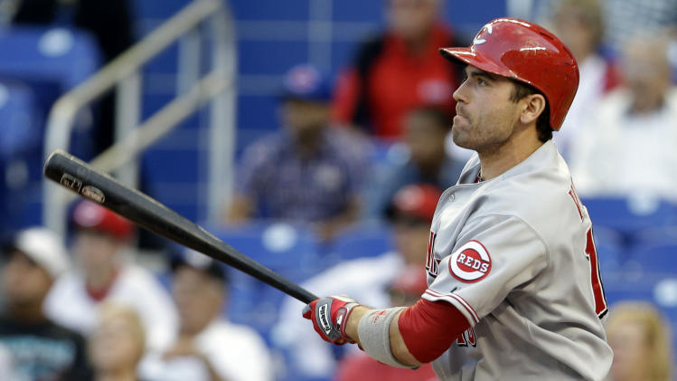 Cincinnati Reds' Joey Votto follows through on a single in the first inning during a baseball game against the Miami Marlins in Miami, Tuesday, May 14, 2013. (AP Photo/Lynne Sladky)