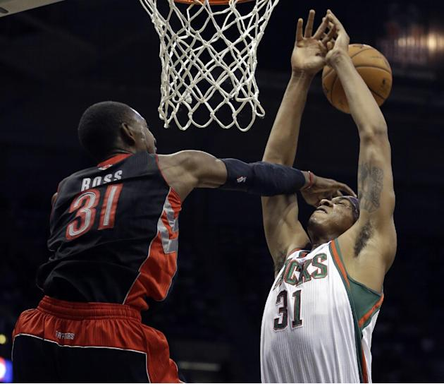 Toronto Raptors' Terrence Ross fouls Milwaukee Bucks' John Henson during the second half of an NBA basketball game Saturday, Nov. 2, 2013, in Milwaukee. The Raptors won 97-90