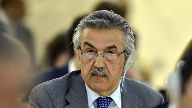 Faysal Khabbaz Hamoui, Ambassador of the Permanent Representative Mission of Syria to Geneva addresses his statement, during the urgent debate on the situation in Syria at the 23rd session of the Human Rights Council, at the European headquarters of the United Nations in Geneva, Switzerland, Wednesday, May 29, 2013. Syria's civil war is spilling out of control and represents a massive failure to protect citizens against war crimes and crimes against humanity that are now a routine occurrence according to the U.N.'s top human rights official Navy Pillay. (AP Photo/Keystone, Martial Trezzini)