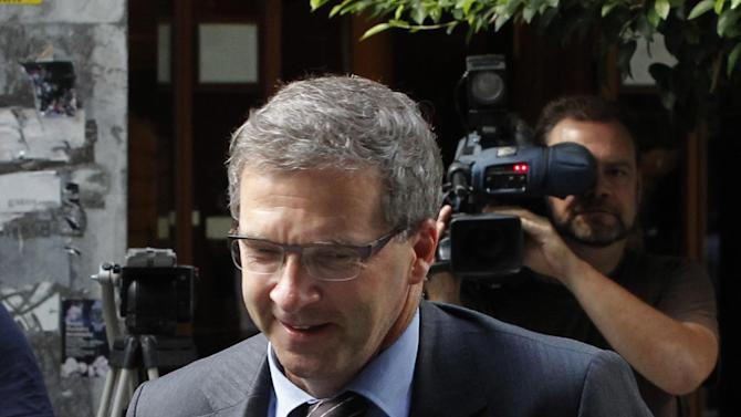 European Central Bank's (ECB) Klaus Masuch, arrives for a meeting between Greece's finance minister Yannis Stournaras and the debt inspectors from the European Central Bank, European Commission and International Monetary Fund, known as the troika  at Greece's Finance ministry in Athens, on Tuesday, Sept. 18, 2012. Debt-strapped Greece is negotiating a major new austerity package worth more than euro 11.5 billion ($15.1 billion) with its rescue lenders. The measures are a requirement for continued emergency loan payments. (AP Photo/Petros Giannakouris)