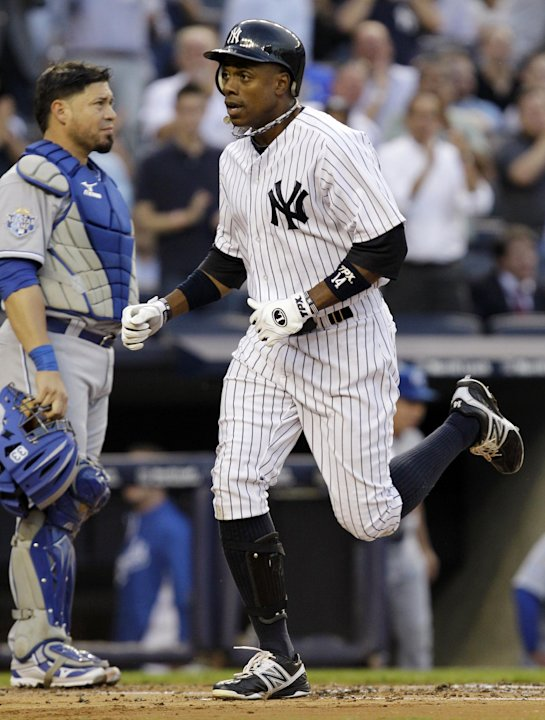 New York Yankees' Curtis Granderson runs past Kansas City Royals catcher Humberto Quintero after hitting a first-inning home run off Kansas City Royals starting pitcher Will Smith during their basebal