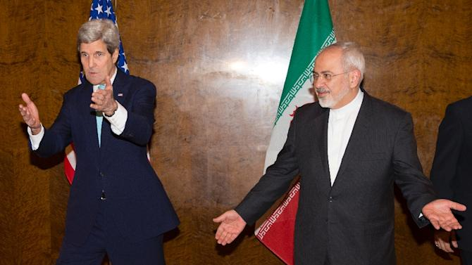 Secretary of State John Kerry (L) and Iranian Foreign Minister Mohammad Javad Zarif, pictured March 2, 2015 at negotiations in Montreux, Switzerland, resumed talks on a nuclear deal Wednesda