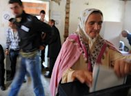 A Bosnian woman casts her vote for local authorities in the Bosnian town of Srebrenica. Bosnia voted in local polls on Sunday with all eyes on Srebrenica, where 8,000 Muslim men were massacred in 1995, amid fears that Serbs could take power in the once Muslim-majority city